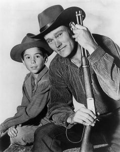 """Chuck Connors Johnny Crawford The Rifleman 1960"" by ABC Television - Licensed under Public Domain via Commons."